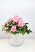Pink rose bud and berry