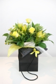 Yellow roses and protea