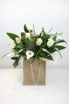 White roses and cala lillies.