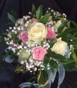 Bouquet for bride showing pink and red roses and other foliage