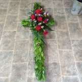 Picture of red rose cross on grey tiled floor