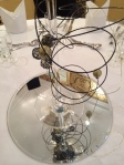 Silver Base onTable reflecting the Gold and Black Martini Glass