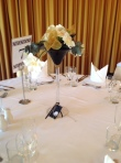 A table centrepiece with gold ribbon in Martini Glass