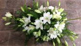 Tribute arrangement of white lilies