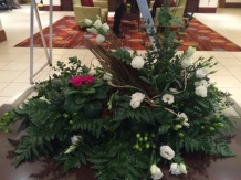 Deep green with white and hit of pink arrangement
