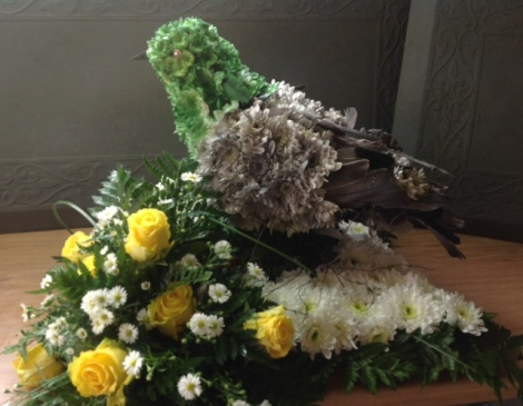 An arrangement in the shape of a pigeon