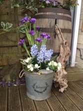 Spring bulbs and flowers in botanicals pot. Silk Version.