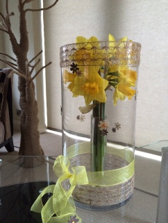 Spring daffodils in a dressed vase