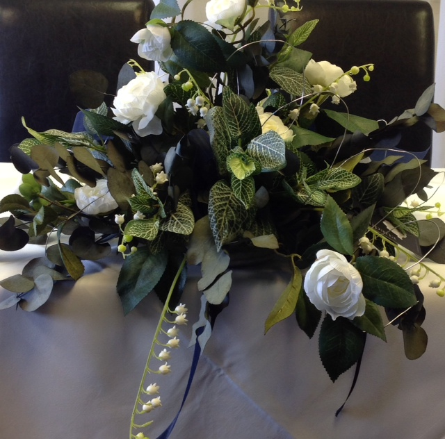 Table Arrangement with gardenia, lily of the valley and foliage