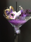 Gold and purple mask in Martini glass