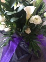 Cala lillies, lisianthus and eucalyptus
