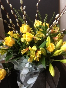 Yellow roses, alstroemerias and pussy willow