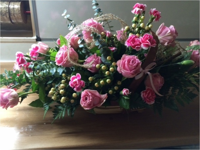 Traditional trug with pink roses
