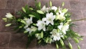 Open white lily arrangement
