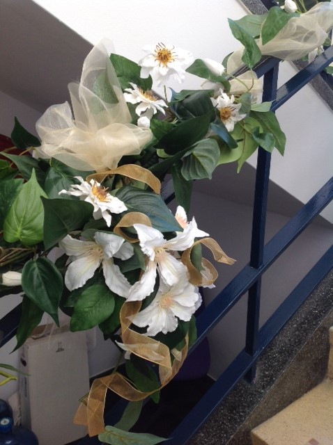 White flowers decorating staircase