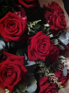 12 Hand-tied red roses. Pictured here in fresh and wrapped in organza.Price £60.00.Available in silk. Price £45.00.